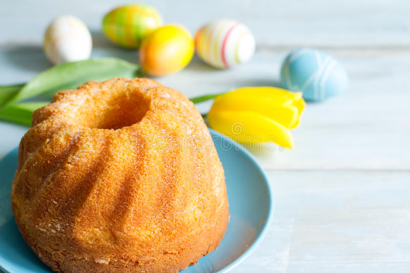 Easter cake and spring tulips royalty free stock photos