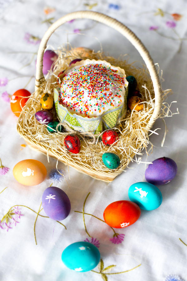 Easter cake with sugar glaze and colorful - yellow, red, violet, green, violet - Easter eggs with white pictures stock photo