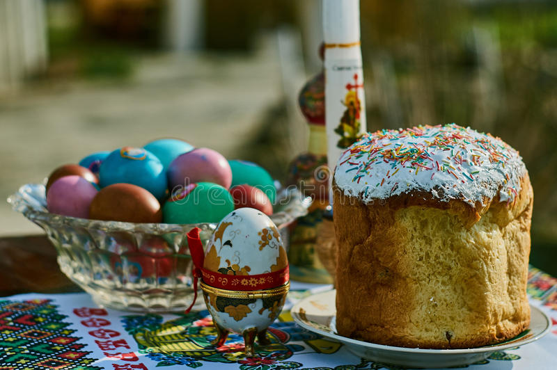 Easter cakes and colored eggs. The cake (from a Ms. Greek. κουλλίκι(ον) from κόλλιξ bread round or oval shape stock photography
