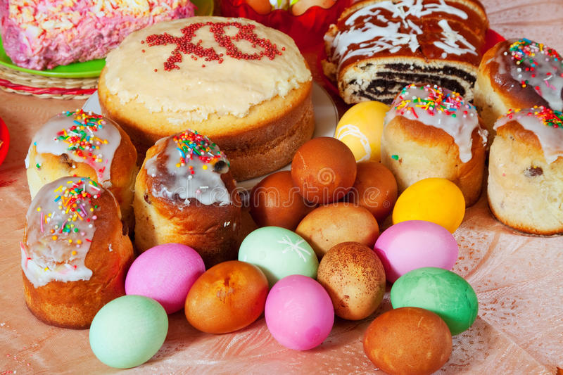 Easter cakes and eggs. On festive table royalty free stock images