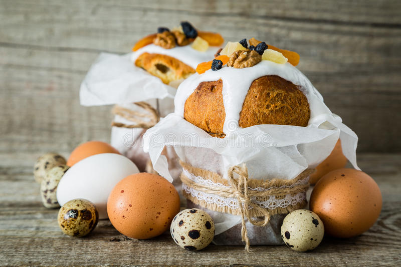 Easter cakes with eggs, rustic wood background royalty free stock photography