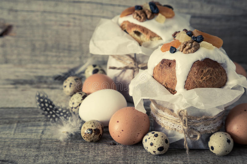 Easter cakes with eggs, rustic wood background royalty free stock image