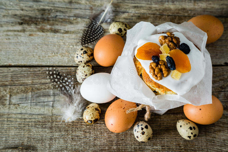 Easter cakes with eggs, rustic wood background stock photo