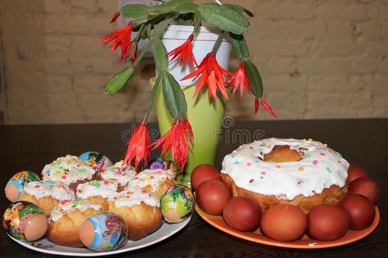 Easter cakes and Easter flowers on a brick wall background royalty free stock photography