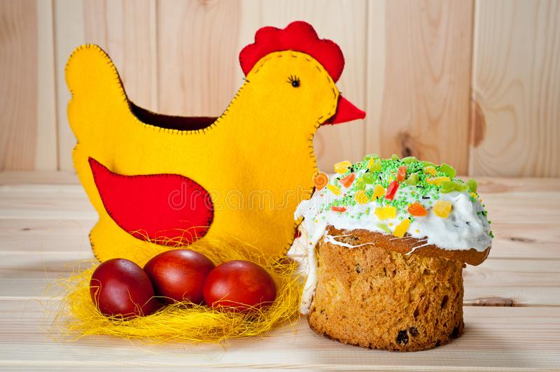 Easter cakes and painted eggs with Easter chicken on a wooden table.  royalty free stock photos