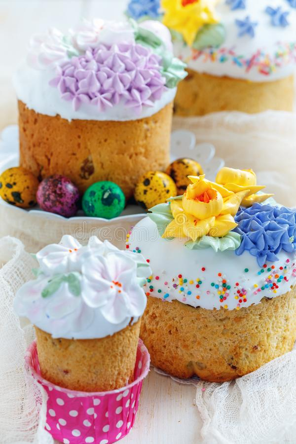 Easter cakes and painted eggs. Easter cakes and painted eggs on white wooden table, closeup, selective focus royalty free stock photography