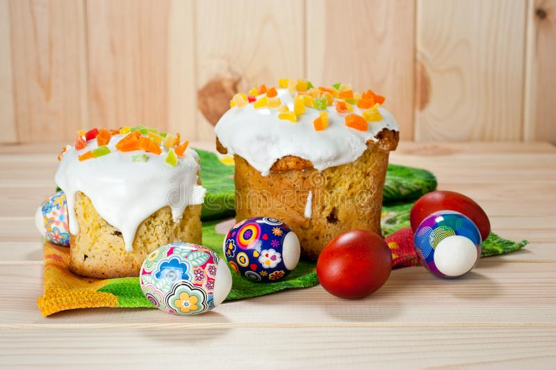 Easter cakes and painted eggs on a wooden table.  royalty free stock image