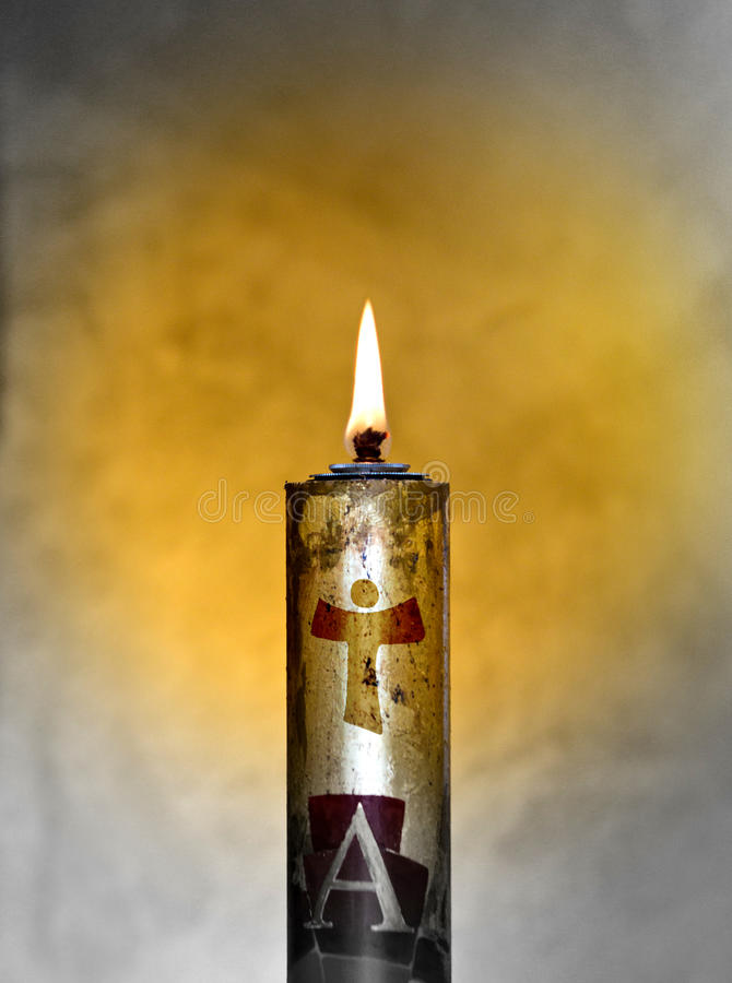 Easter candle welcomes the light of the holy spirit. Paschal candle with its light comes from the Holy Spirit and always accompanies the body of Christ stock image