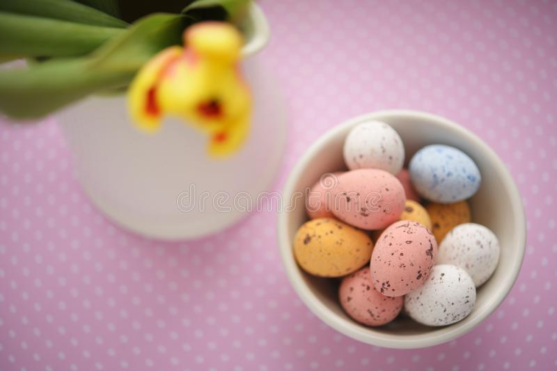 Easter candy egg and defocused tulip royalty free stock images