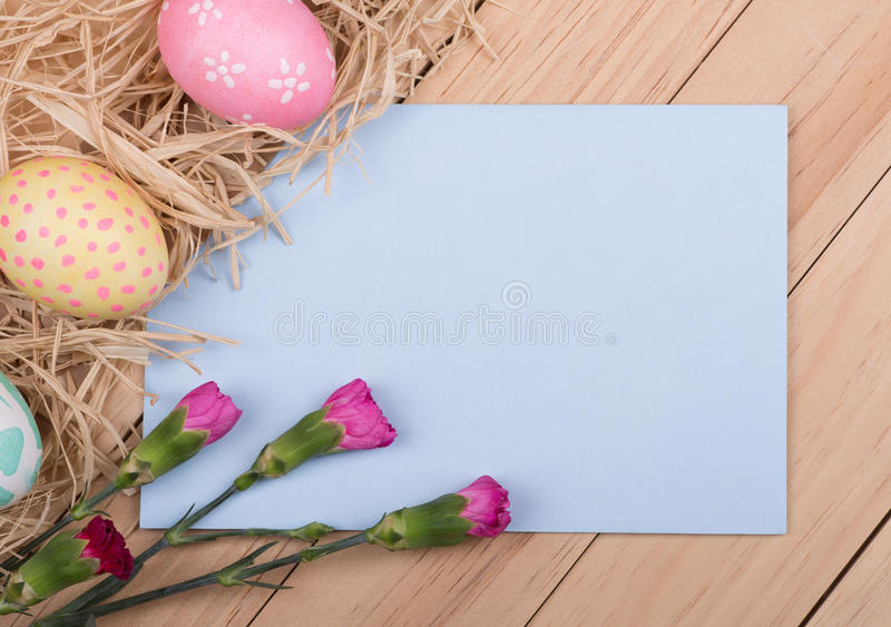 Easter Card. Blank envelope with decorated Easter egg and flower border stock photos