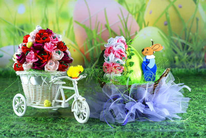 Easter card, Easter egg chick and basket with hare - handicraft. Easter card, Easter egg chick and basket with hare. Green grass and Easter bouquets stock image