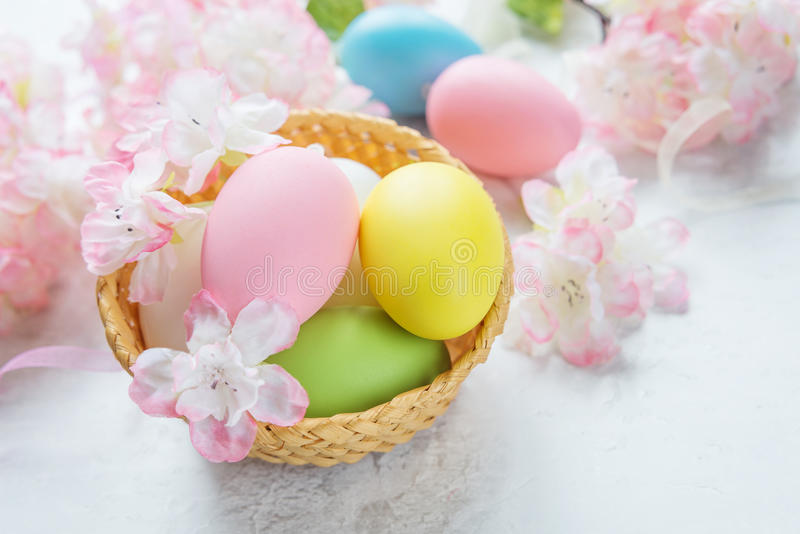 Easter card with easter eggs and pink flowers stock images