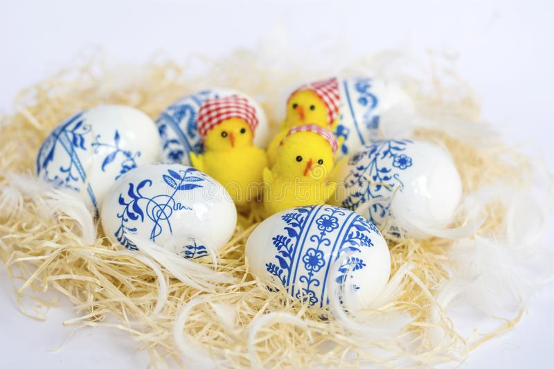 Beautiful Easter Eggs with Blue Painted Flowers and Chickens royalty free stock image