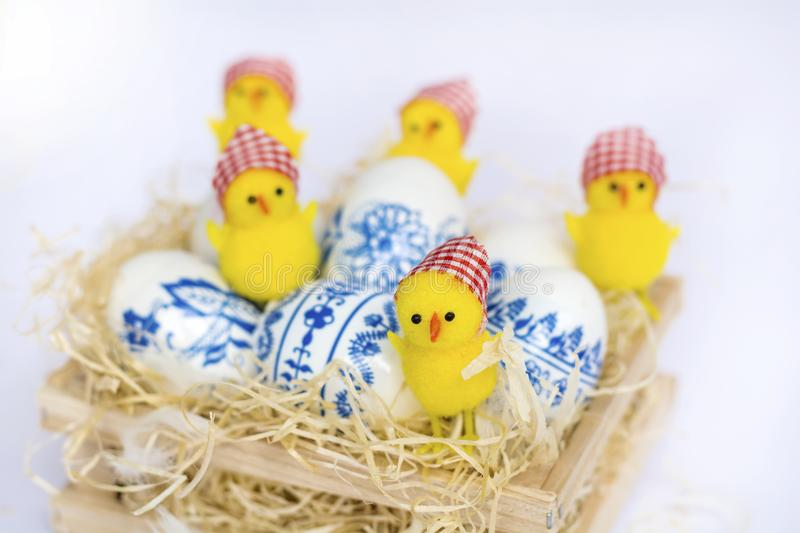 Beautiful Easter Eggs with Blue Painted Flowers and Chickens stock photos
