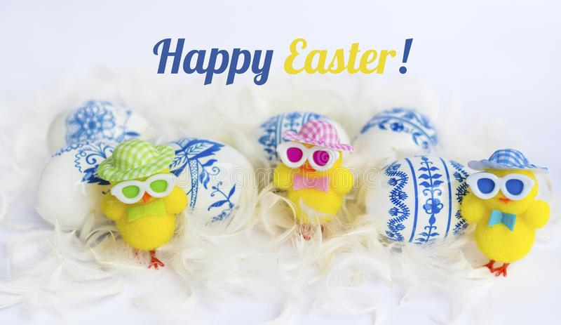Beautiful Easter Eggs with Blue Painted Flowers and Yellow Chickens stock photography