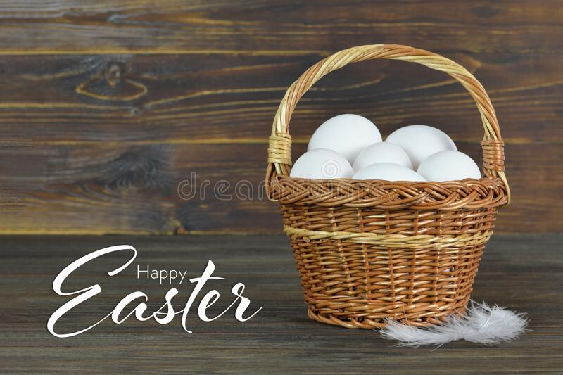 Easter card with chicken eggs in basket. Easter card with white chicken eggs in basket stock photography