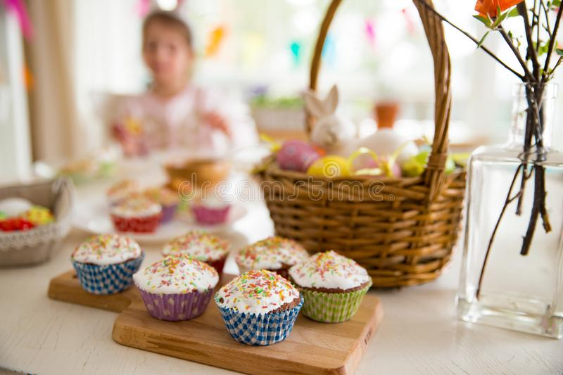 Easter celebration, close-up table with glazed cupcakes, royalty free stock photo