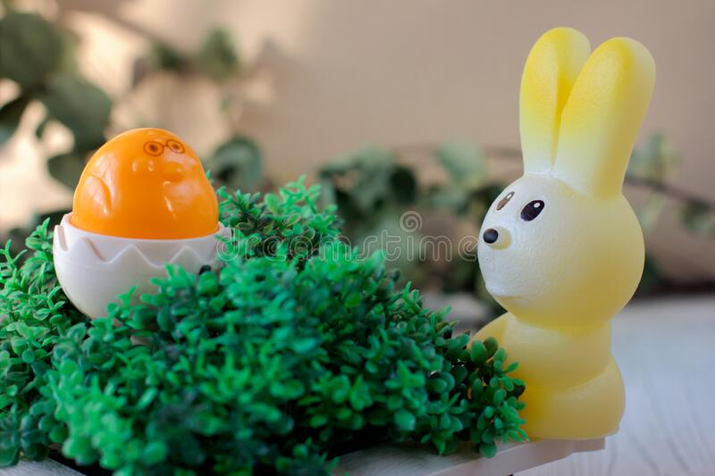Easter celebration concept. toy bunny and chicken on grass. happy easter and spring project. Easter celebration concept. toy bunny and chicken in shell on grass royalty free stock photo