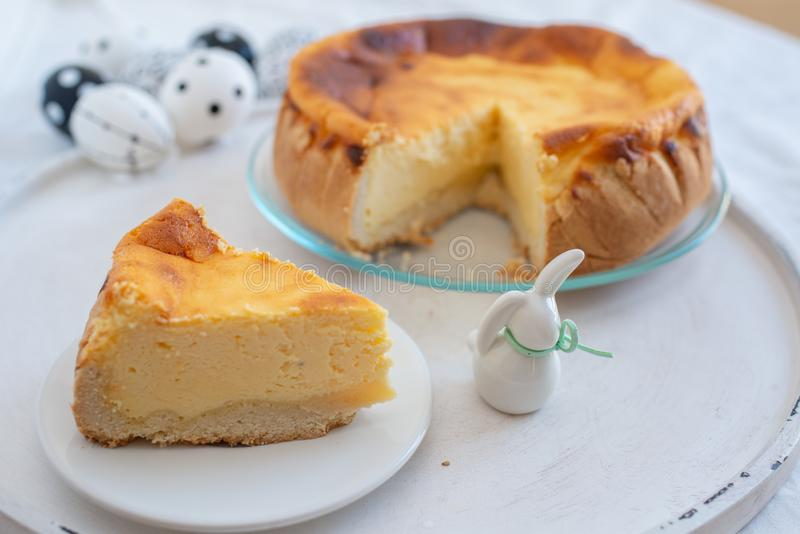 Easter Cheesecake with Easter Eggs on a table royalty free stock image