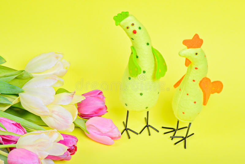 Easter chickens and pink tulips stock photography