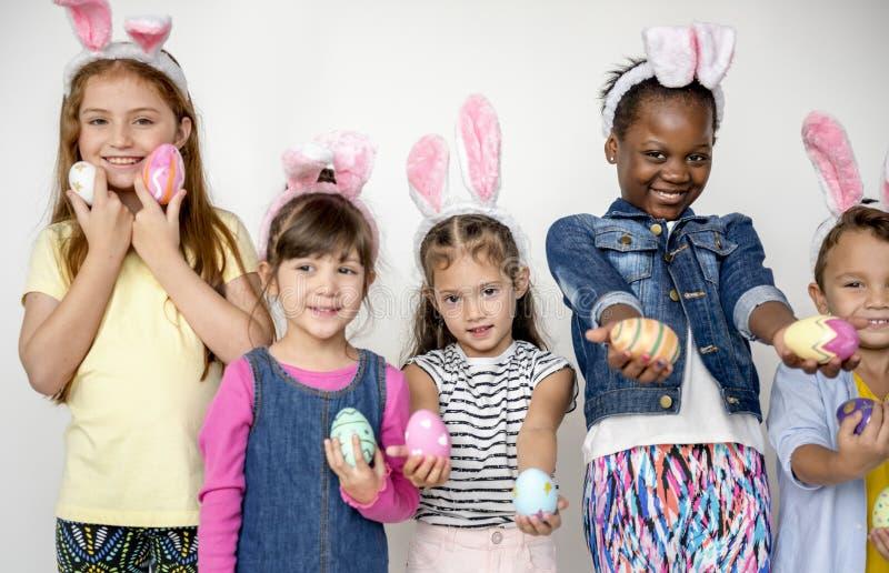 Easter Children Together Studio Concept stock photos