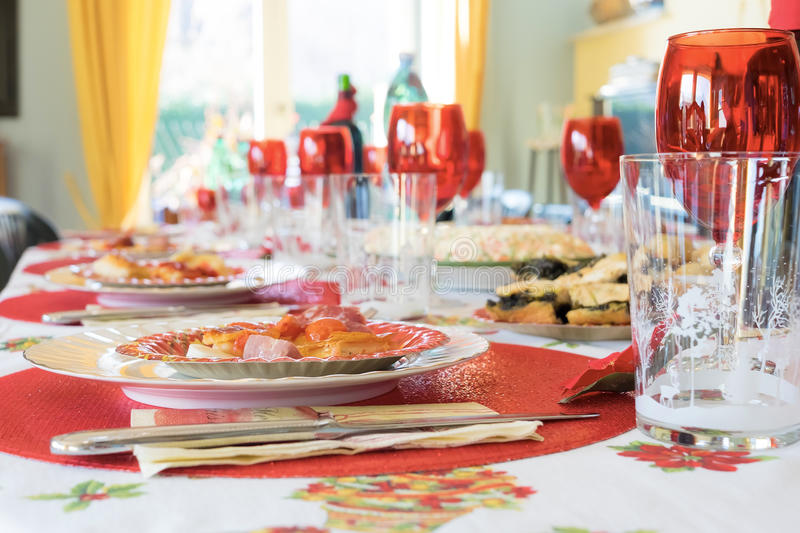 Easter Christmas eve thanksgiving holiday party table with red g. Lasses and plate royalty free stock photos