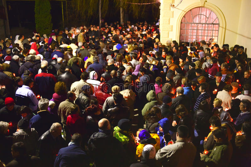 Easter church crowd. Of people gathered for the procession at night. Romanian Christian community royalty free stock image