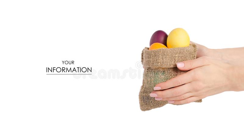 Easter color eggs in bag in hand pattern royalty free stock photo