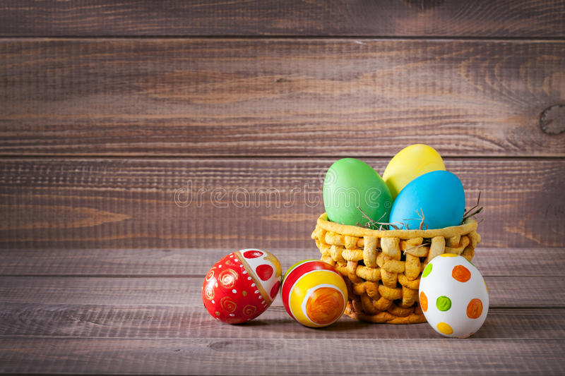 Download Easter Color Eggs In Basket On Wood Stock Images - Image: 37680034