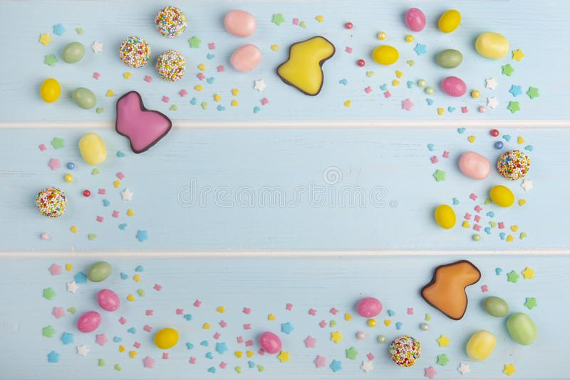 Easter colorful chocolate bunnies, sweets and bright sprinkles royalty free stock photos