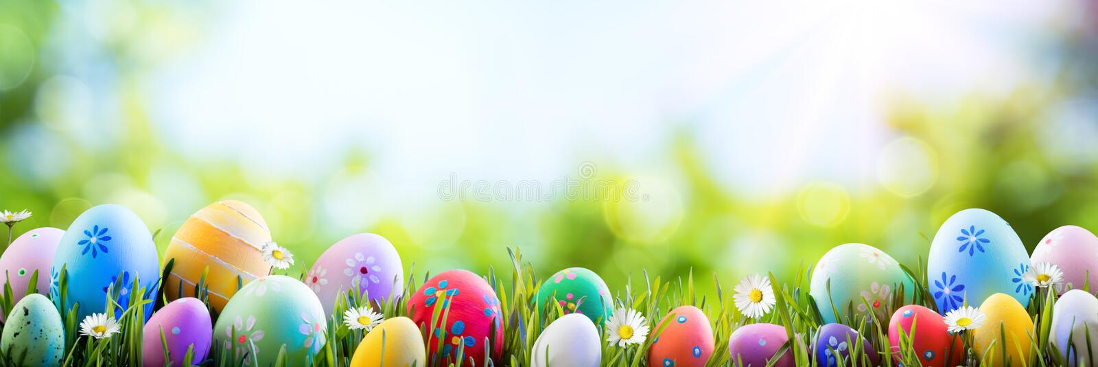 Easter - Colorful Decorated Eggs. On Field stock photos