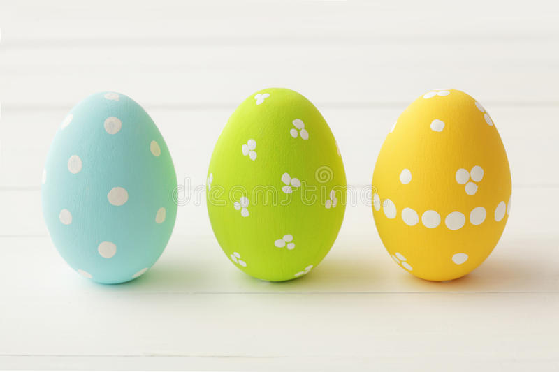 Easter. Colorful decorated easter eggs on wooden background royalty free stock image