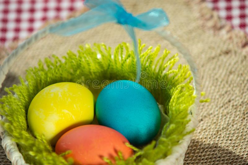 Easter colorful eggs in a basket stock image