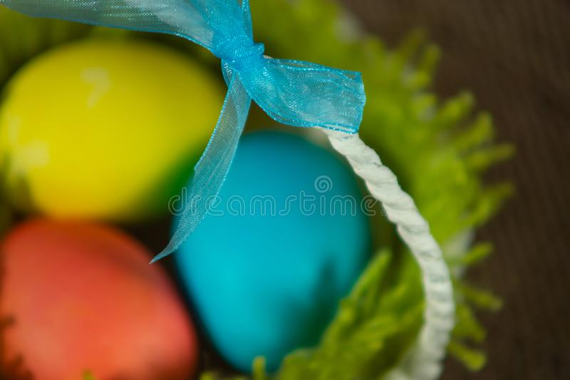Easter colorful eggs in a basket royalty free stock photography
