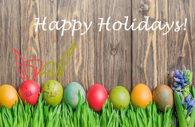 Easter colorful eggs and cute bunny in green grass stock photo