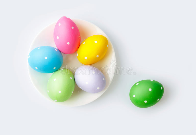 Easter colourful eggs on plate stock photography