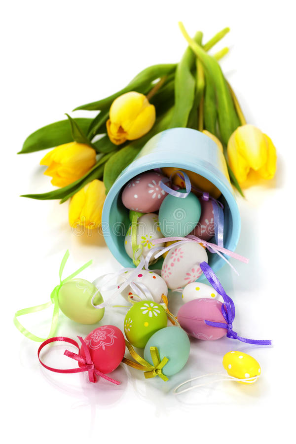 Easter composition. With fresh tulips and easter eggs over white royalty free stock photography