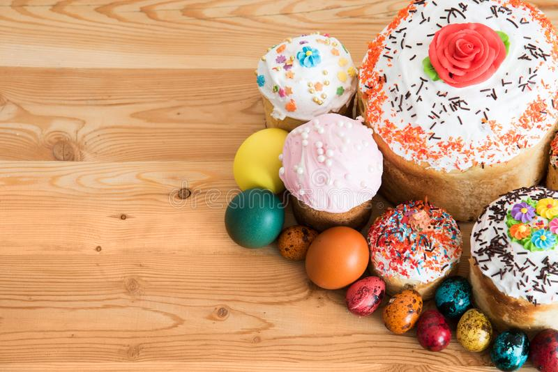 Easter composition with Easter cakes and painted eggs on a wooden background stock photography