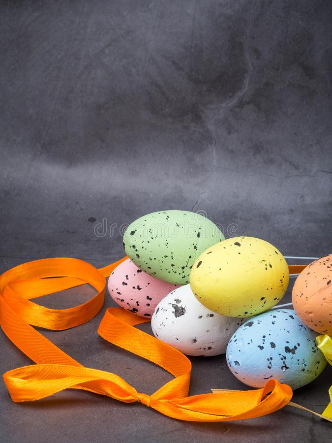 Easter composition with colorful eggs on grey background, space for text stock images