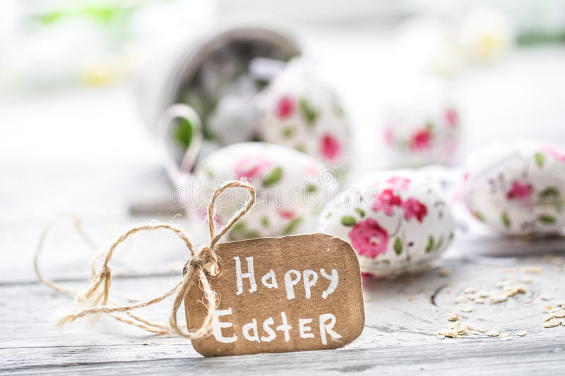 Easter composition with eggs in a bucket. And with the inscription happy Easter is on a light wooden background royalty free stock images