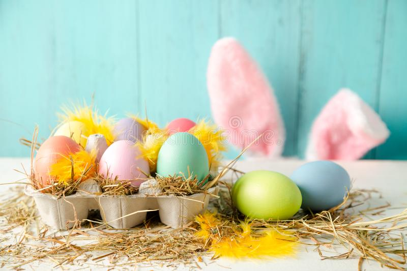 Easter composition in pastel colors with eggs and rabbit ears stock photos