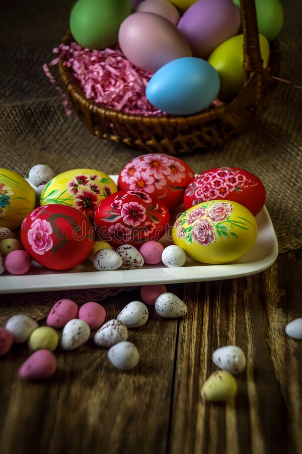 Easter composition on a wooden background. Hand painting Easter eggs. The concept of religious holidays, family traditions. stock image