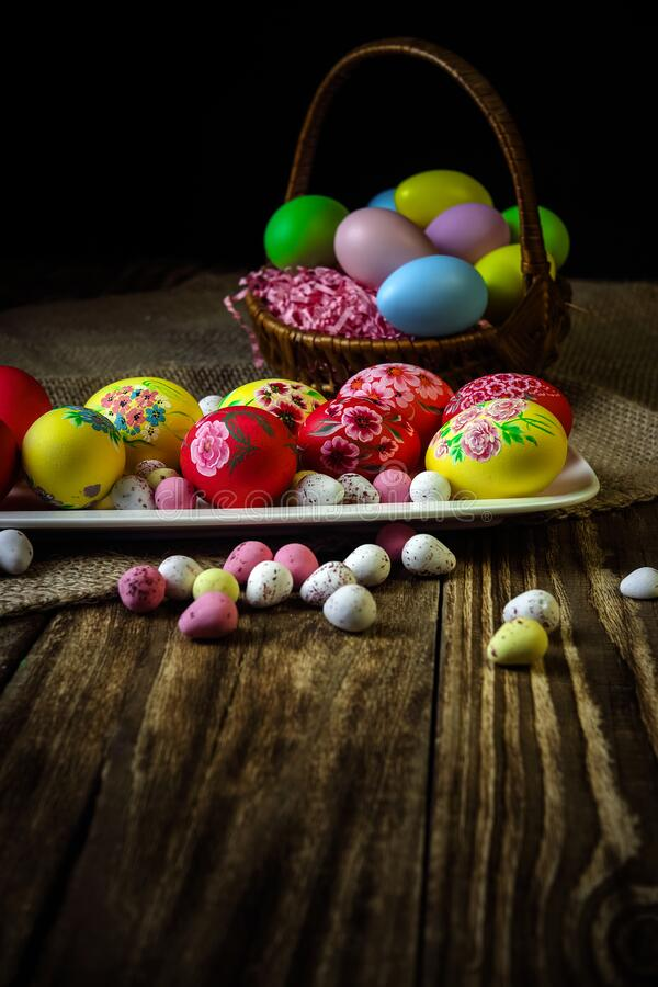 Easter composition on a wooden background. Hand painting Easter eggs. The concept of religious holidays, family traditions. stock images