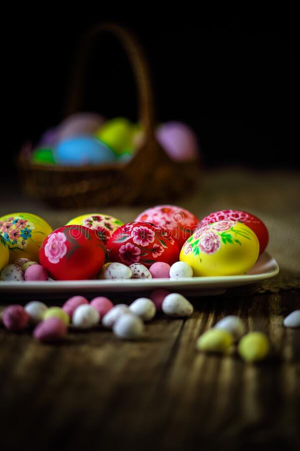 Easter composition on a wooden background. Hand painting Easter eggs. The concept of religious holidays, family traditions. royalty free stock photo