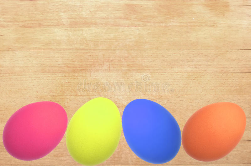 Easter concept with colorful eggs on wooden background stock photos