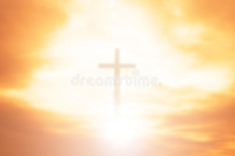 Easter concept:Silhouette cross on Calvary mountain sunset background. Religious cross against the background of the rays of the setting sun, symbolizing `faith royalty free stock photo