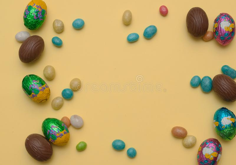 Easter concept.. Stylish Frame background with quail, gold and blue easter eggs with copy space for text. isolated on background. stock photos