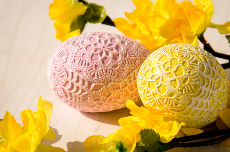 Easter concept. Yellow and pink easter egg and spring flower royalty free stock photos