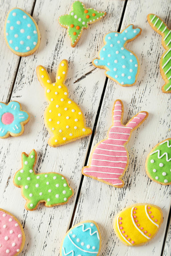 Easter cookies. Colorful easter cookies on white wooden background stock images