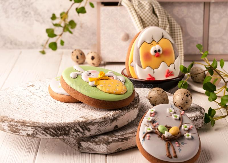 Easter cookies with painted easter bunny, easter eggs and hatched chicken royalty free stock images